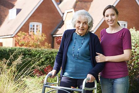 Registered Nurse Helping Senior