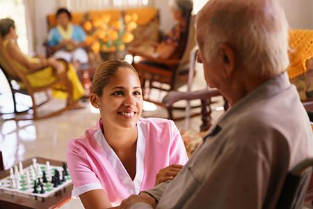Caregiver Helping Senior Through End of Life Care
