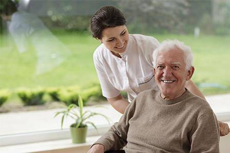 Senior Man Getting Home Care By Registered Nurse