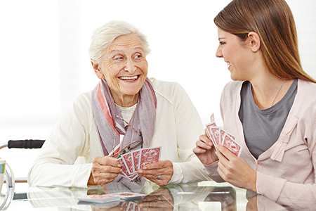3-20 Senior Home Care Worker Playing Games With Elder Woman