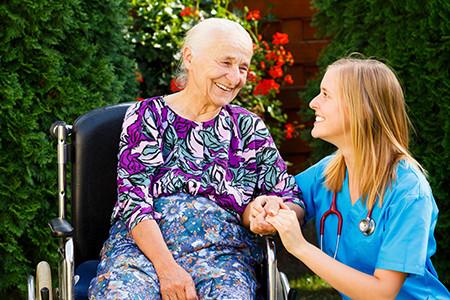 Female Caregiver Helping Elderly Woman 2-10
