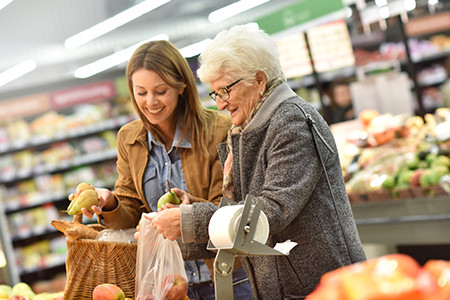 Caregiver able to help elderly woman at grocery store as part of in home care