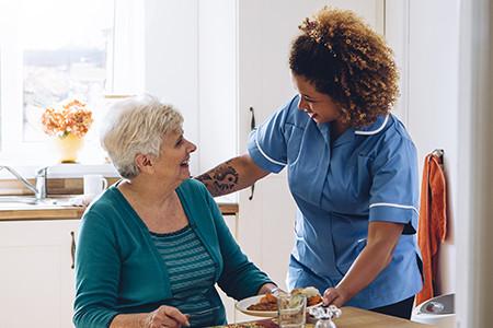 Registered Nurse taking care of elderly Lady
