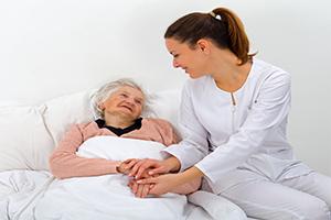 woman-giving-elderly-care-to-elder