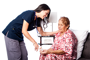 senior-lady-taking-medication-with-assistance