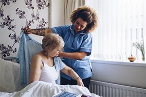 elderly-woman-getting-assistance