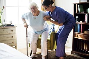 caregiver-providing-assistance-to-elderly-lady