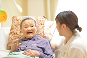 registered-nurse-helping-elderly-lady